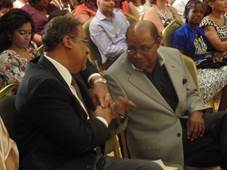Minister Edmund Bartlett (right) shares a light moment with his predecessor Dr. Wykeham McNeill at the opening of JAPEX 2016